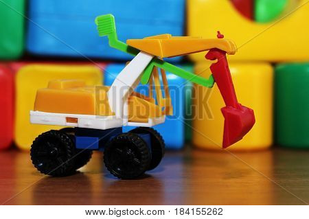 Car toy on the background of colored cubes, isolated