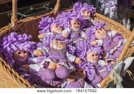Avignon, France, September 9, 2016: Handmade dolls for sale at a tourist shop in Avignon