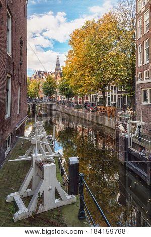 Amsterdam Netherlands - October 30 2016: The lock between Сanal Oudezijds Kolk and Oudezijds Voorburgwal in the center of Amsterdam