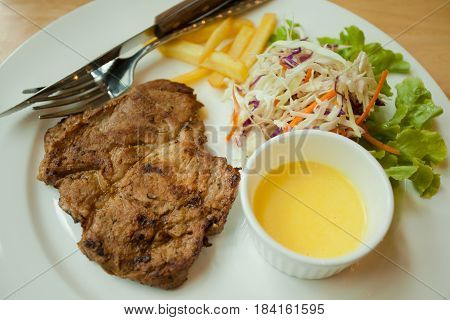 steakjuicy grilled pork chop neck cut with green