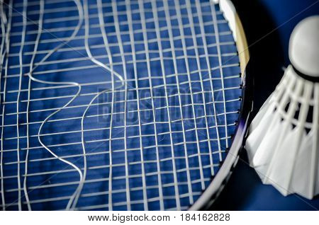 Close-up of badminton racket absence and badminton shuttle cock