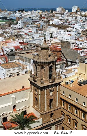 CADIZ, SPAIN - SEPTEMBER 8, 2008 - Elevated view of the city rooftops and Santiago church Bell tower Cadiz Cadiz Province Andalusia Spain Western Europe, September 8, 2008.