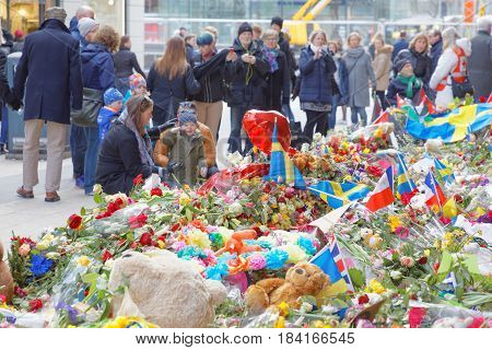 STOCKHOLM SWEDEN - APR 17 2017: Lots of flowers and candles in central Stockholm from people paying respect to the victims in the terror attack in Stockholm April 07 2017. April 17 2017 in Stockholm Sweden