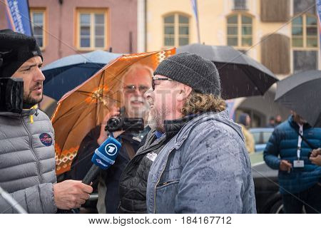 NeuoettingGermany-April 28,2017: German actor Armin Rohde talks to a TV reporter after arriving at the Neuoetting stage of the Arabella Classics Rally