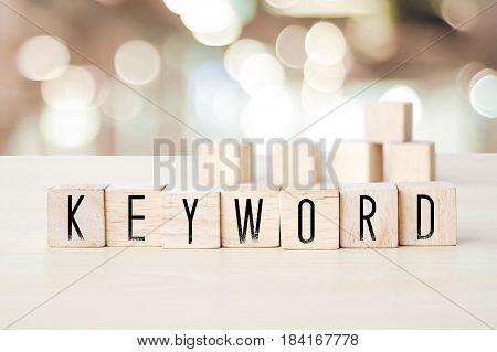 Keyword word on wooden cubes background SEO concept
