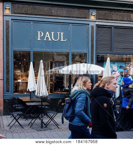 STRASBOURG FRANCE - APR 27 2017: Paul Boulangerie Et Patisserie cafe with open air terrace on French street. Paul is a French chain of bakery/cafe restaurants established in 1889 in the city of Croix in Northern France