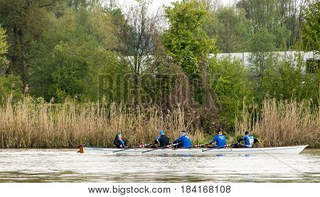 Neuoetting,Germany-April 29,2017: A Scull participating at the Inn-Beaver regatta from Neuoetting to Muehldorf approaches the staging area in Neuoetting