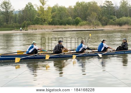 Neuoetting,Germany-April 29,2017: A scull participating at the Inn-Beaver regatta from Neuoetting to Muehldorf crosses the start line