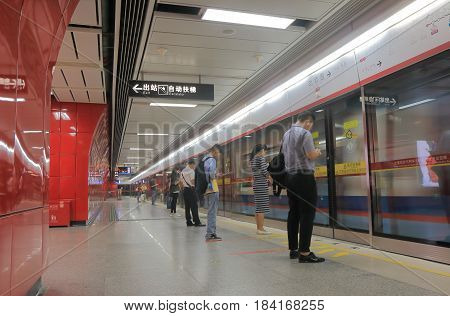 GUANGZHOU CHINA - NOVEMBER 14, 2016: Unidentified people commute by subway in Guangzhou downtown.