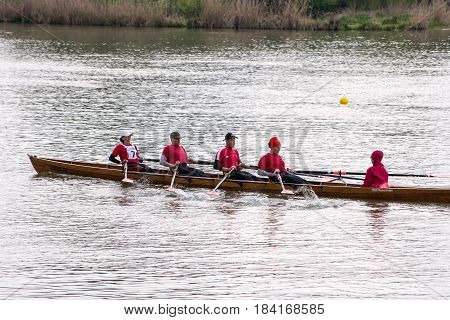 Neuoetting,Germany-April 29,2017: ASculls participating at the Inn-Beaver regatta from Neuoetting to Muehldorf crosses the start line