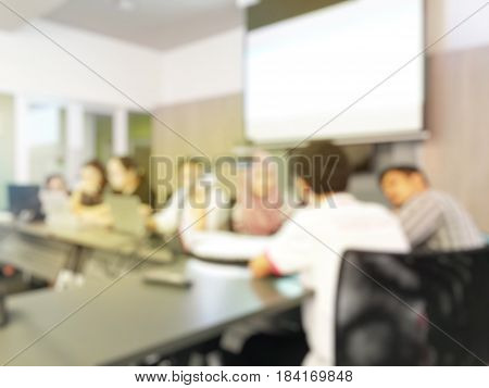 Blurred Image Of Education People Sitting In Meeting Room For Profession Seminar Or Education Media