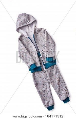 Grey children's sportive costume isolated on the white background. Jacket with hood. Sportive style of children. Concept of the children's fashion industry. Clothes for boys.