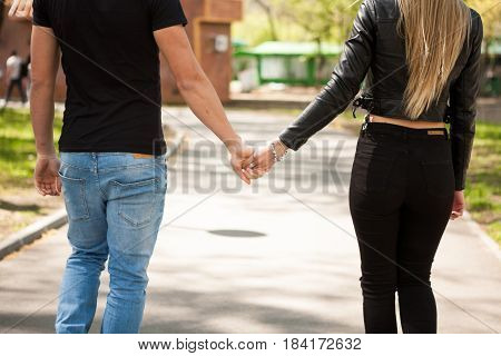 Close up of couple holding hands. In love and relationship. Happines and love