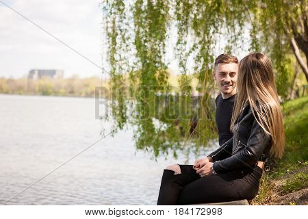Beautiful Couple on th edge of lake posing at camera. In love and relationship. Happines and love