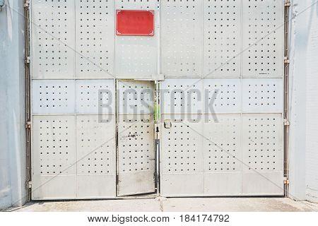 Scary Rusty Metal Door With Door Locked Attached