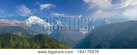 Panorama of the south face of the Annapurna South peak Hiunchuli peak Modi Khola valley and Fishtail Mountain on the background of sky with clouds in morning in the Himalayas