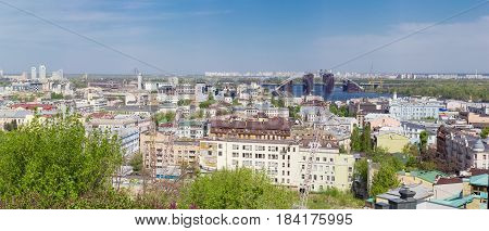 Panorama of the Podil - the historic neighborhood of Kiev from Castle Hill in springtime Ukraine.