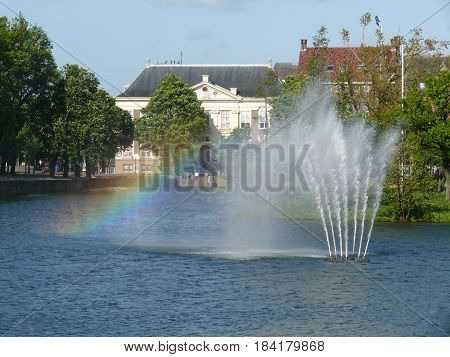Hague city view. Fountain with rainbow. Hague, Netherlands