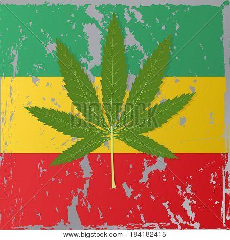 Cannabis leaf on the background of the Rastafarian flag.