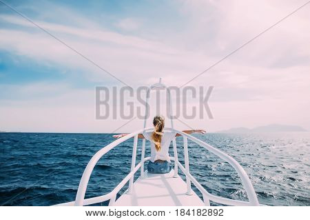 Young Woman In Front Of Nose Of White Yacht With Raised Hands Enjoy The Wind And Sea. Summer Vocatio