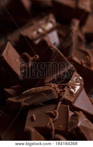 Milk Chocolate. Milk Chocolate Pieces On A Wooden Background