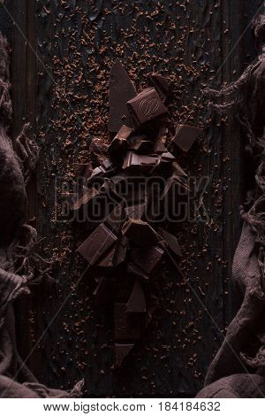 Bitter Dark Chocolate On A Dark Wooden Background.