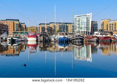 Boats moored at Limehouse Basin Marina in London