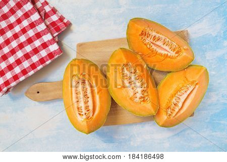 Tasteful fresh melon fruit slices on the table top view