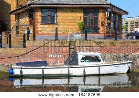 Patrol boat moored at Limehouse Basin Marina in London