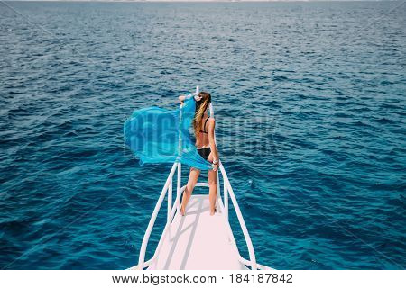 Woman On Yacht Nose With Blue Scarf Wave On Wind. Summer Time Vocation On Yacht.