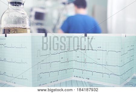Recorded ECG results on the medical worker background