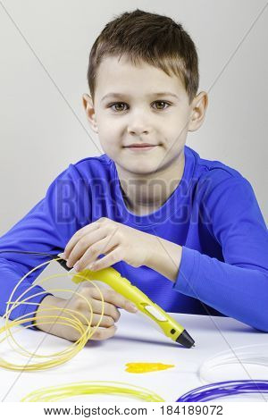 Boy using 3D printing pen. Creative, leisure, technology education concept