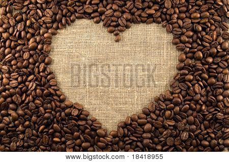 Coffee beans heart on light canvas