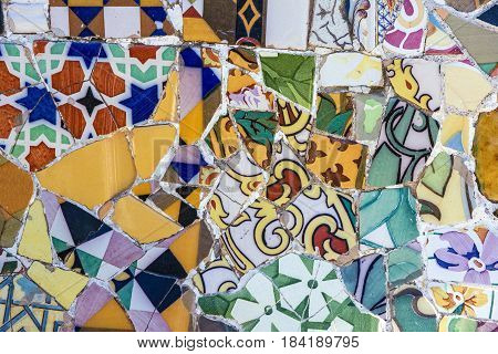 Broken multicolor glass mosaic tile decoration in Barcelona, Spain.