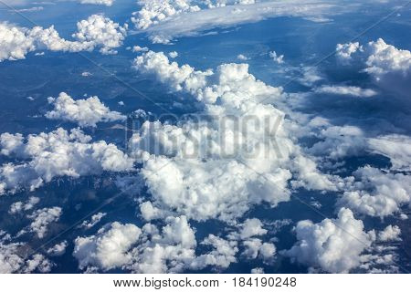 Blue sky natural view with white clouds closeup.