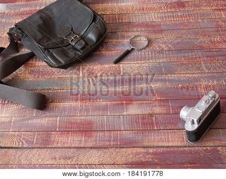 Vintage still life of random objects of modern mans on wooden board