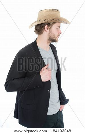 Cowboy Hat In Hand Of Happy Businessman In Suit Jacket