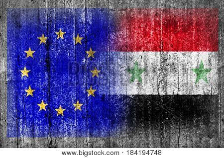 EU and Syria flag on concrete wall