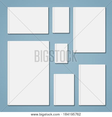 A set of white empty book templates of different sizes with proportions closest to