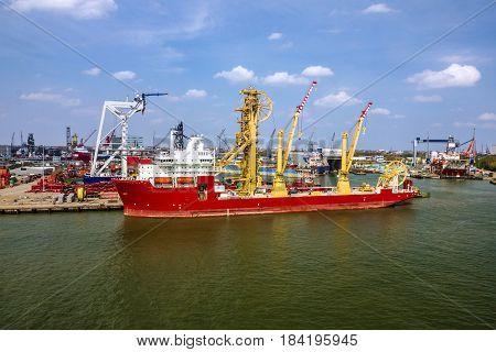 Cargo vessel in sea port Rotterdam, Netherlands.