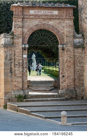 San Quirico d'Orcia, Tuscany, Italy - April  23, 2017: the entrance gate of the Horti Leonini, in the old centre of the village