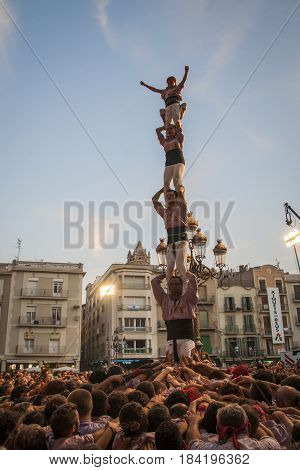 REUS SPAIN - October 01 2011: Castells Performance. A castell is a human tower built traditionally in festivals within Catalonia. This is also on the UNESCO Intangible Cultural Heritage