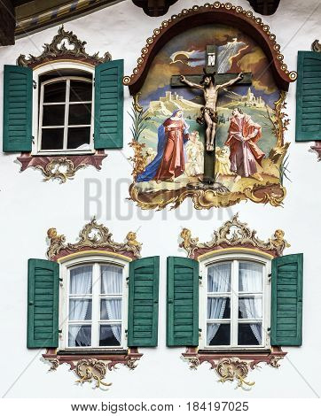 Bavaria, Germany - May 1, 2017: Painting house wall with crucifixion in village Oberammergau, Bavaria, Germany