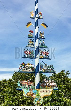 Munich, Germany - May 1, 2017: Bavarian Maypole on Viktualienmarkt a famous delicatessen market
