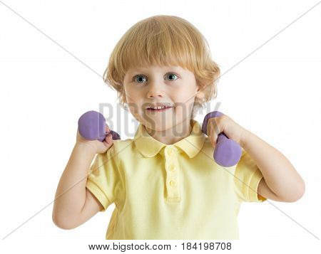 Cute child with dumbbells. Portrait of sporty kid boy in yellow t-shirt isolated on white background.