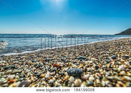 Pebbles in Perdepera shoreline in Sardinia, Italy
