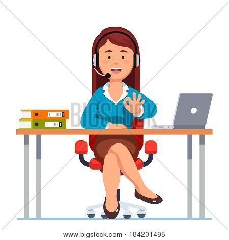 Operator of call center or office worker in headphones sitting at her desktop showing ok gesture. Young woman working with laptop. Flat style modern vector illustration isolated on white background.