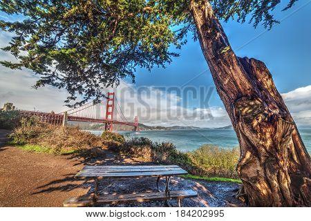 Wooden bench by Golden Gate bridge California