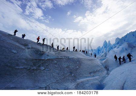 Line of people walking on Perito Moreno glacier in Patagonia, Chile