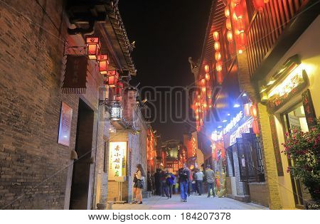 GUILIN CHINA - NOVEMBER 16, 2016: Unidentified people visit East West street. East West street features boutiques, galleries, traditional teahouses, bars and cafes in folk styles.
